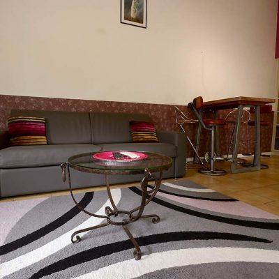 Salon du gîte Cosy et son canapé rapido