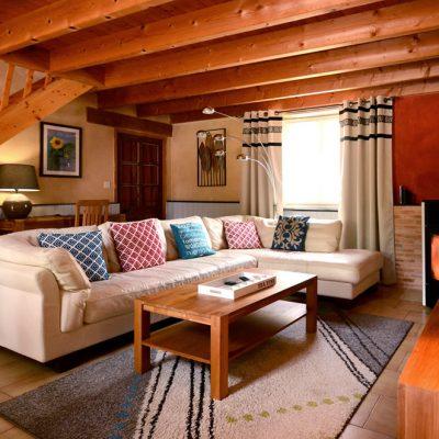 Le salon et son canapé cuir 6 places